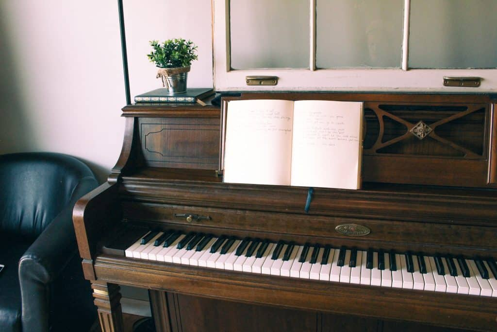 songwriting set up on old piano