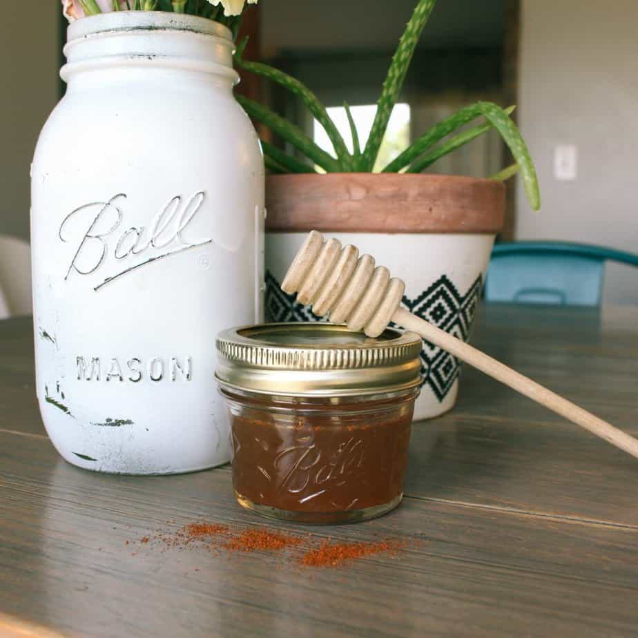 sore throat gargle in half pint mason jar with cayenne pepper sprinkled in front