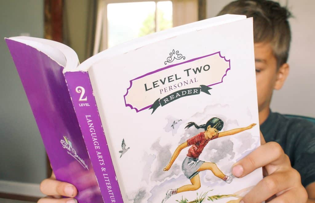 child reading the good and the beautiful level two personal reader