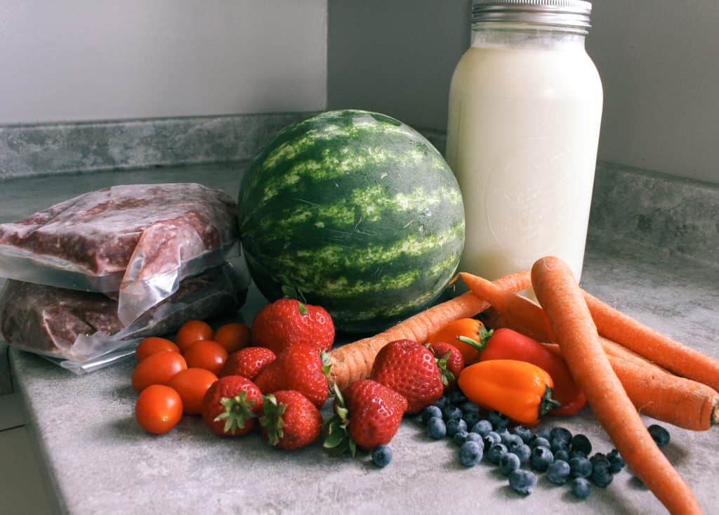 local and organic produce and meat and milk on countertop