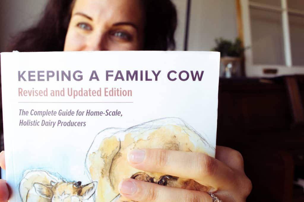 woman reading keeping a family cow book