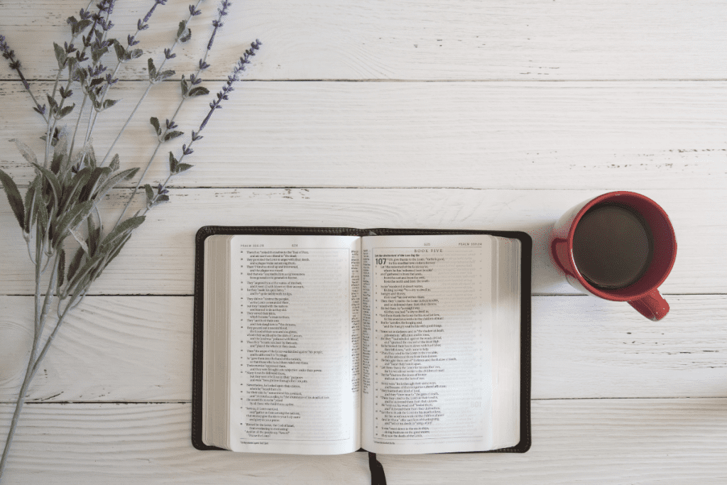 open bible with coffee mug and lavender surrounding it